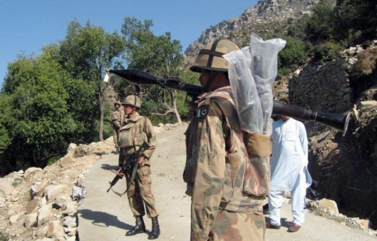 Vingt soldats pakistanais ont été tués samedi matin par une attaque d'hélicoptères de l'Otan sur un poste militaire à la frontière avec l'Afghanistan. – Ihsan Ullah afp.com