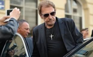 Johnny Hallyday, le 1er septembre 2017, aux obsèques de Mireille Darc à l'église Saint-Sulpice (Paris).