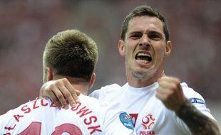 Les joueurs polonais Blaszczykowski et Obraniak (à dr.) lors du match de l'Euro contre la Grèce, le 8 juin 2012.