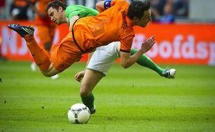 """Le racisme a fait une entrée remarquée à l'Euro-2012 avec les déclarations de Mark van Bommel, capitaine des Pays-Bas, dénonçant des """"cris de singe"""" pendant un entraînement à Cracovie (Pologne) et relançant ainsi le débat sur la conduite à tenir en match en cas d'incidents"""
