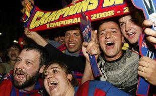 Les supporters du FC Barcelone, fêtant le titre de leur équipe, acquis sans jouer, samedi 16 mai 2009.
