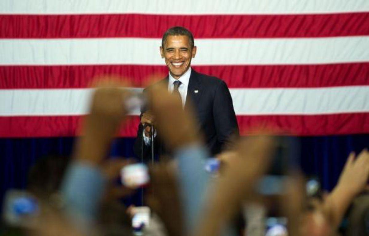 Le président sortant Barack Obama et son camp, loin d'observer une trêve, vont tenter de voler la vedette aux républicains en faisant campagne à un rythme soutenu pendant les débats de la convention nationale de leurs adversaires la semaine prochaine en Floride. – Jim Watson afp.com