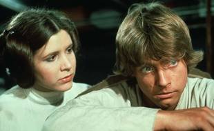 """Star Wars Trilogy"" (1977,1980, and 1983) Carrie Fisher (Princess Leia) and Mark Hamill (Luke Skywalker) (Photo Credit: 20th Century Fox_LucasFilm LTD/Shooting Star) *** Please Use Credit from Credit Field ***/sipausa.sipausa_16330233/*** World Rights ***/1511041720"