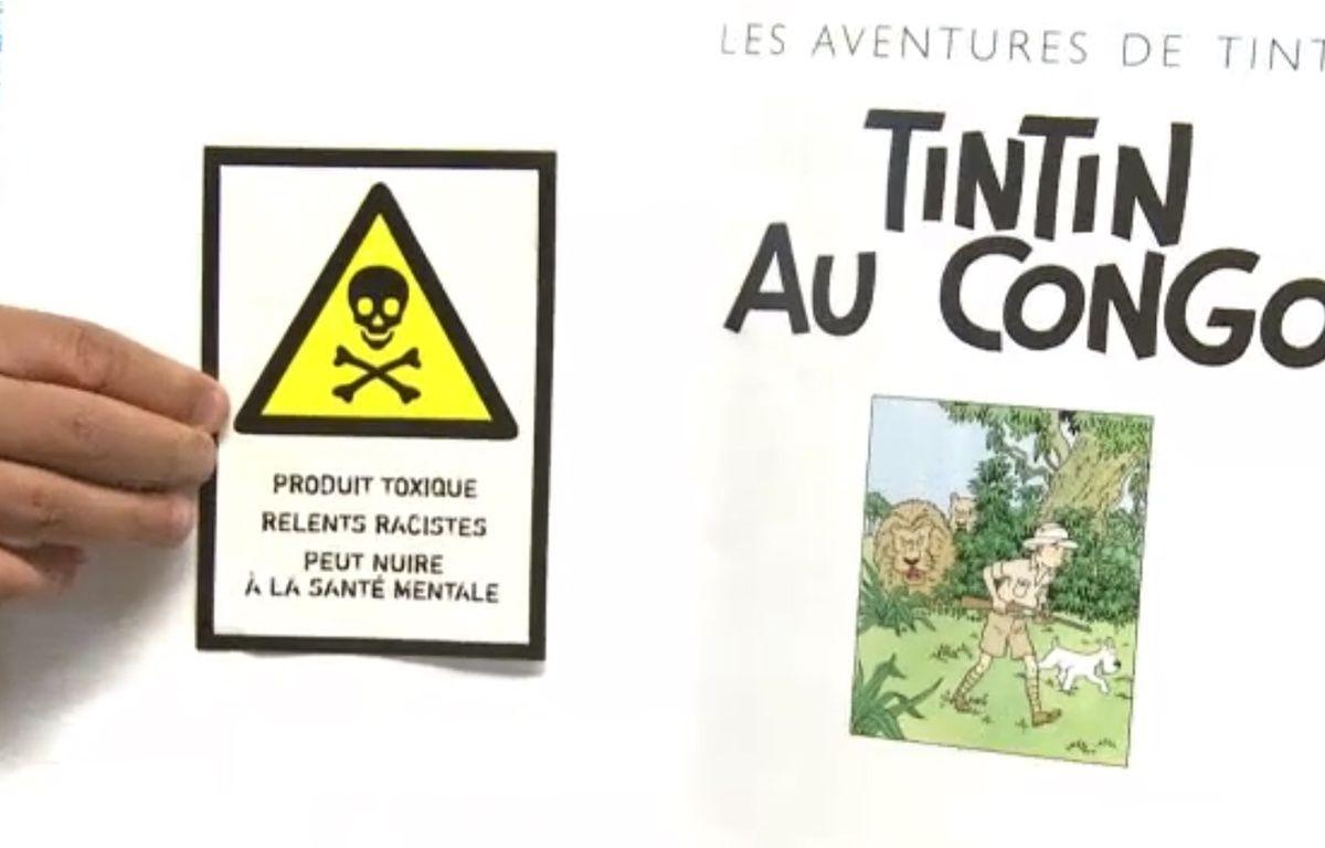 Des autocollants collés sur un album Tintin au Congo. – 20 Minutes / AFP