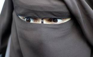 Hind Ahmas, attends a press conference on December 12, 2011 in front of the police tribunal in Paris, after being fined for violating France's niqab ban. In France, a woman who repeatedly insists on appearing veiled in public can be fined 150 euros and ordered to attend re-education classes. AFP PHOTO / MIGUEL MEDINA
