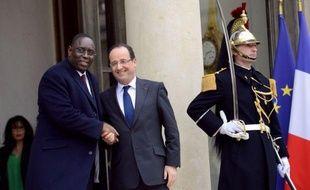 """Le président François Hollande a affirmé vendredi sa volonté que la France poursuive """"une politique ambitieuse"""" d'aide au développement malgré la crise, indiquant qu'un projet de loi à ce sujet serait déposé au Parlement à l'automne prochain pour une adoption en 2014."""