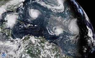 L'ouragan Florence (en ht. à g.), la tempête Isaac (au centre) et  l'ouragan Helene, le 11 septembre 2018.
