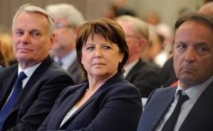 Martine Aubry entourée de Jean-Marc Ayrault et Jean-Pierre Bel au Conseil national du parti socialiste, le 14 mai 2012.