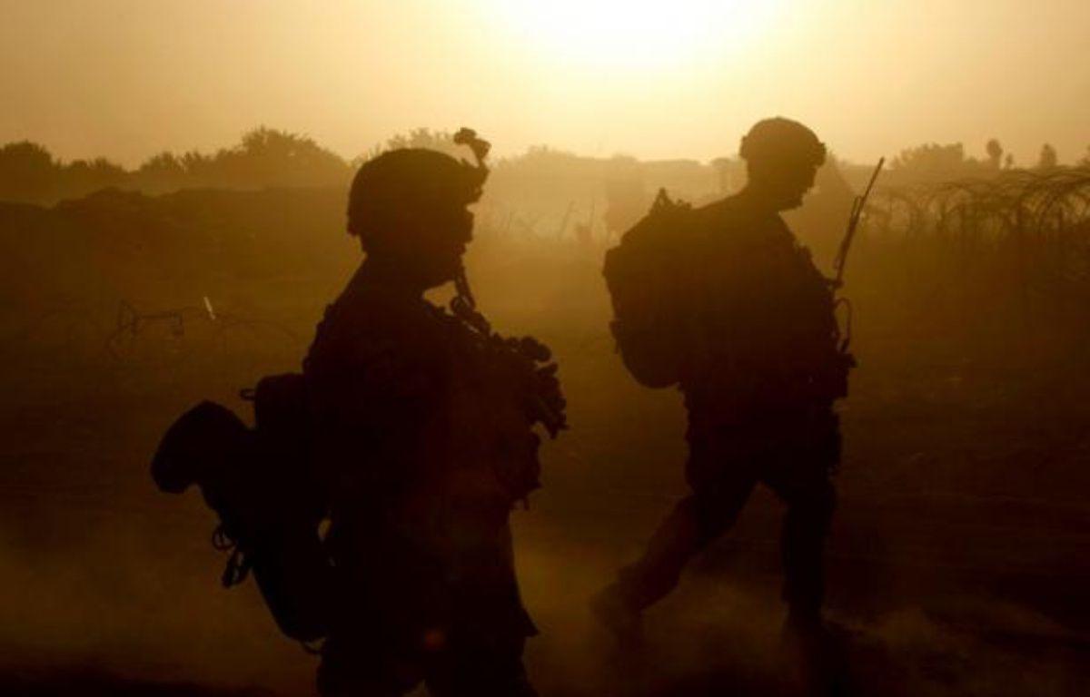 Des soldats américains patrouillent dans le sud de l'Afghanistan, le 22 juin 2011. – B.RATNER/REUTERS