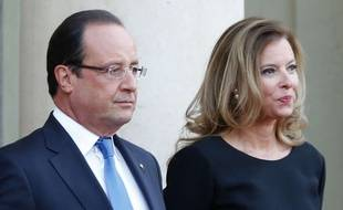 "FILE - In this Sept. 3, 2013 file photo, French president Francois Hollande and his companion Valerie Trierweiler wait for German President Joachim Gauckand, at the Elysee Palace, in Paris. Trierweiler' s book ""Merci pour ce moment"" (Thanks for this moment) relates her life at the presidential palace and will go on sale Thursday.  (AP Photo/Jacques Brinon, File)/PAR107/649826630427/SEPT 3, 2013 FILE PHOTO/1409031110"