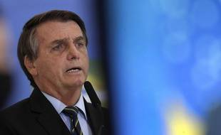 Le président Jair Bolsonaro, ici le 25 mars, a été condamné après des propos machistes et dégradants à l'encontre d'une journaliste.