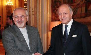 Le ministre iranien des Affaires étrangères Hassan Rohani et son homologue français Laurent Fabius, au Quai d'Orsay à Paris, le 5 novembre 2013