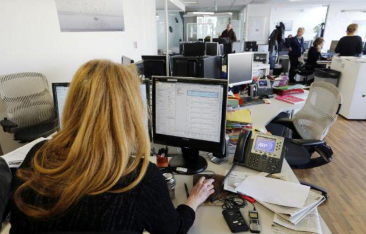 Une journaliste de l'AFP, à Paris, le 17 février 2014 – FRANCOIS GUILLOT AFP