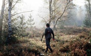 Un homme en train de chasser. (Illustration)