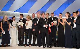 Le jury de Jane Campion (à g.) lors de la cérémonie de clôture du 67e festival de Cannes, avec Nuri Bilge Ceylan (le 3e à g.) entre autres lauréats