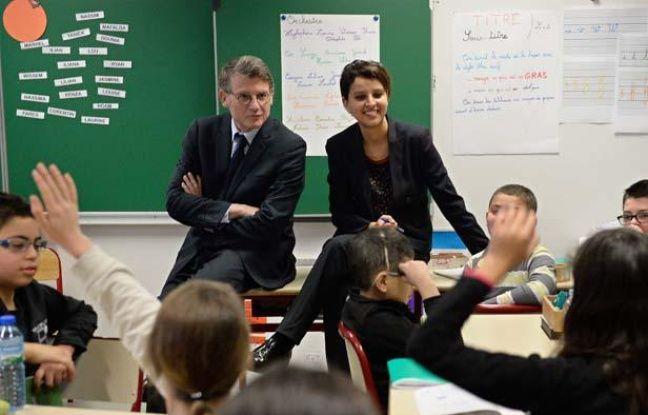Vincent Peillon et Najat-Vallaud Belkacem, le 13 janvier 2014 à Villeurbanne, lors d'un déplacement sur les modules «ABCD de l'égalité».