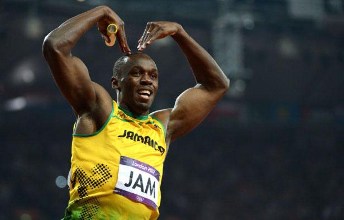 Usain Bolt à l'arrivée du 4x100m, le 11 août 2012, à Londres.  – OLIVIER MORIN / AFP