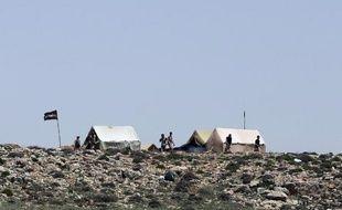 Des combattants du Hezbollah campent sur une colline dans la région du Qalamoun, au Liban, à la frontière avec la Syrie, le 20 mai 2015