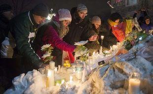 Les Québécois se recueillent au lendemain de la fusillade qui s'est déroulée dans une mosquée de Québec