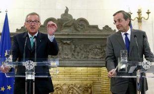 Jean-Claude Juncker (g), le nouveau président de la Commission européenne et le Premier ministre grec Antonis Samaras à Athènes le 4 août 2014