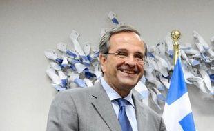 """La directrice générale du FMI, Christine Lagarde, a appelé mardi le Premier ministre grec Antonis Samaras à avancer sur les """"réformes"""" économiques tout en le félicitant pour les """"progrès"""" accomplis, à l'issue d'une entrevue à Washington."""