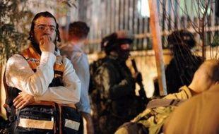Outre les huit morts israéliens, l'auteur de l'attaque, un habitant de Jérusalem-est, a été tué rapidement après l'attentat, qui s'est produit peu après 20h30 locales (18H30 GMT) dans le quartier de Kyriat Moshé.