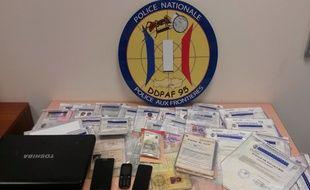 Des faux documents, un ordinateur et des clés USB ont été saisis au cours des perquisitions dans une boutique africaine du 18e à Paris.