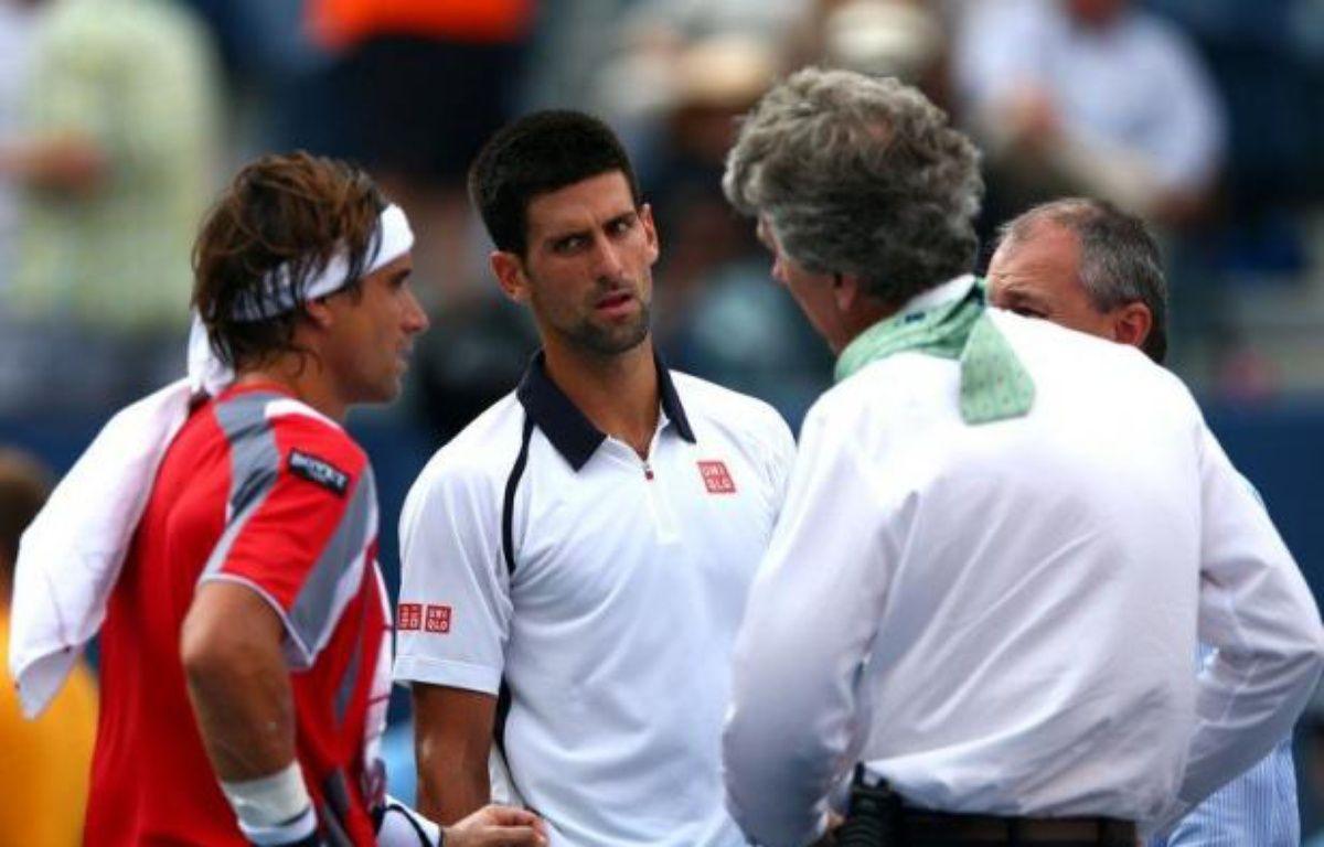 La finale messieurs de l'US Open, prévue dimanche, a été reportée à lundi car la deuxième demi-finale entre Novak Djokovic (N.2) et David Ferrer (N.4) a dû être suspendue en raison des conditions météo et ne reprendra que dimanche, ont annoncé les organisateurs. – Elsa afp.com