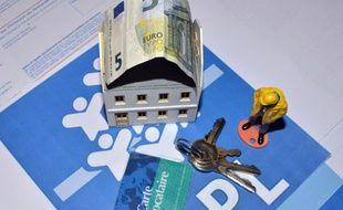 Illustration d un billet de 5 euros devant un immeuble de location social