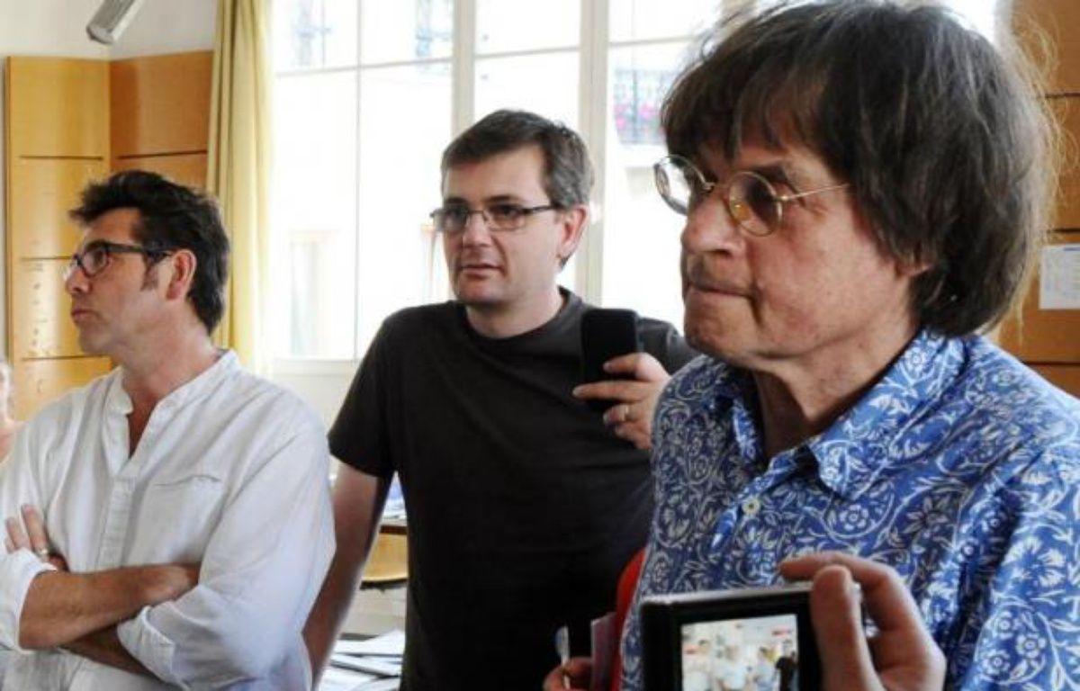 Les dessinateurs Tignous (g), Charb (c) et Cabu au siège de Charlie Hebdo à Paris, le 15 août 2011 – Miguel Medina AFP