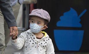 Un enfant à Pékin, le 14 octobre 2016.