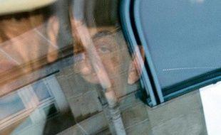 Le président de l'uMP et ex-président de la République Nicolas Sarkozy arrive au Pôle financier du TGI de Paris, le 1er avril 2015