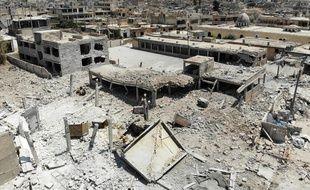 Cette vue aérienne du fichier, prise le 3 août 2019, montre des bâtiments détruits dans la ville de Khan Cheikhoun, dans la campagne du sud de la province d'Idlib, au nord-ouest du pays.