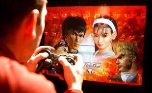 Illustration: Un homme joue à un jeu vidéo.