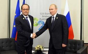 Francois Hollande et Vladimir Poutine le 15 novembre 2014 au sommet du G20 à Brisbane, en Australie