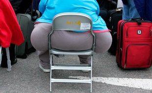 Un passager obèse, à l'aéroport d'Heathrow, en Grande-Bretagne