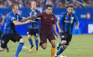Juan Iturbe (au centre), ici au Canada lors d'un match amical le 3 août dernier face à Montreal. Graham Hughes/The Canadian Press via AP