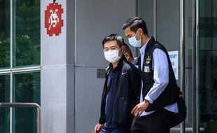Arrestation du rédacteur en chef du quotidien Apple Daily Ryan Law, jeudi 17 juin à Hong Kong.