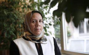 Latifa Ibn Ziaten, dont le fils Imad, un militaire de 30 ans, fut la première victime de Mohamed Merah, pose à Paris le 11 juin 2014