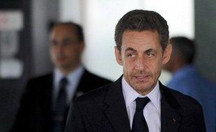 L'ancien président de la République Nicolas Sarkozy, après une rencontre avec la présidente brésilienne Dilma Rousseff à Brasilia, le 22 octobre