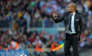 """Le départ de l'ancien entraîneur du FC Barcelone Pep Guardiola pour le Bayern Munich a créé un """"choc"""" dans le monde du football, affirme la presse espagnole jeudi"""