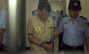 Lee Joon-Seok, le commandant du ferry sud-coréen Sewol, le 24 juin 2014 à son arrivée au tribunal de Gwangju, en Corée du Sud.
