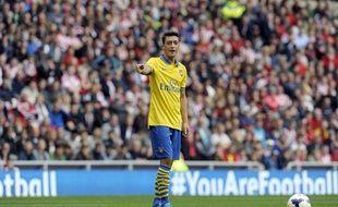 L'attaquant d'Arsenal Mesut Özil lors d'un match contre Sunderland, le 14 septembre 2013.