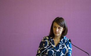 """Cécile Duflot, ministre EELV du Logement, a tenu à souligner mardi que la transition écologique était un """"cap politique à réaffirmer très fortement"""", alors que sa collègue à l'Écologie, Delphine Batho, avait déploré dans la matinée la baisse de ses crédits pour 2014."""