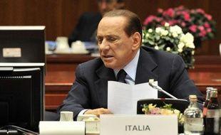Après d'intenses tractations avec la Ligue du Nord et un accord a minima sur les retraites, le chef du gouvernement italien Silvio Berlusconi va présenter mercredi à Bruxelles une lettre dans laquelle il s'engage à effectuer des réformes économiques.