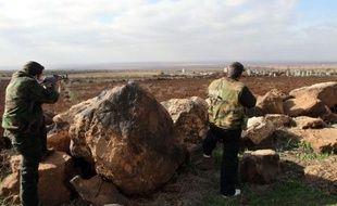 Des habits maculés de sang, des façades de maisons noircies, des murs effondrés, témoignent de l'intensité des combats qui ont opposé dans la montagne druze près de Soueida, dans le sud de la Syrie, l'armée et les habitants aux rebelles venus de Deraa.