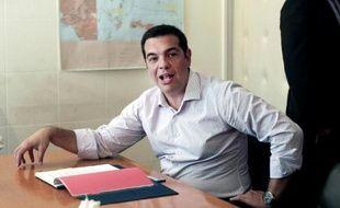 Le Premier ministre grec Alexis Tsipras s'exprime lors d'une réunion avec des membres de son gouvernement au sujet de la question des migrants, à Athènes le 7 août 2015