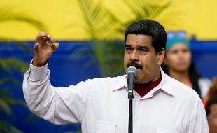 Le président Nicolas Maduro lors d'un meeting à Caracas, le 14 juin 2016. Il avait menacé il y a deux mois les entreprises qui voudraient cesser leurs activités en raison de la crise économique qui frappe le Venezuela