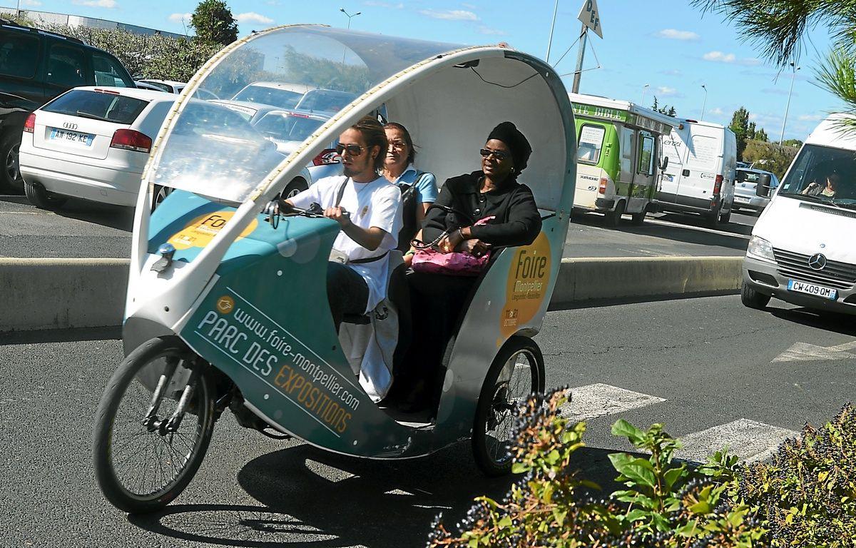 Les vélos-taxis peuvent transporter jusqu'à deux personnes. – Nicolas Bonzom / Maxele Presse