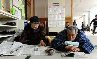 Des habitants de Fukushima dans un centre d'évacuation, le 13 mars 2011.